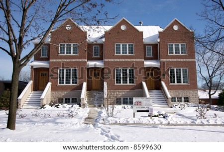 Modern Townhome Facade on a Snowy Winter Day - stock photo
