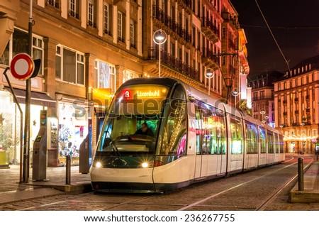 Modern tram in the Strasbourg city center. France, Alsace - stock photo