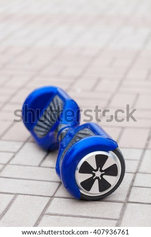 Modern transportation technology - electric mini segway or hover board scooter.Fun way to ride the city streets on electric power.This is the future of transport that produces no air pollution - stock photo