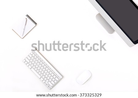 Modern trendy Working Place of Designer with large Computer Monitor Keyboard Notepad Pen and Mouse on White Desk black Screen - stock photo