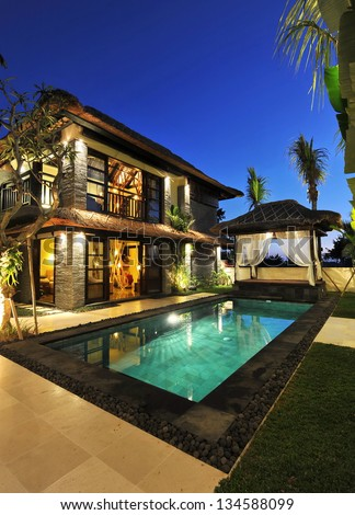 Modern tropical Villa with swimming pool - stock photo