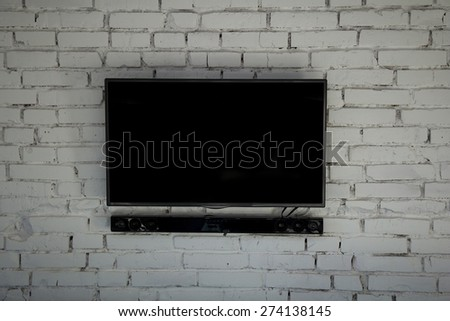 Modern tv wall with white bricks. - stock photo