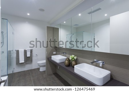 Modern twin bathroom in stylish Australian home - stock photo