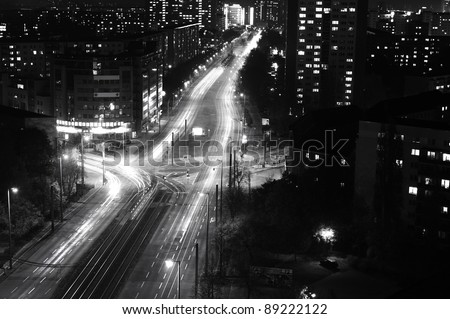 Modern Urban City at Night with Freeway Traffic, black and white - stock photo