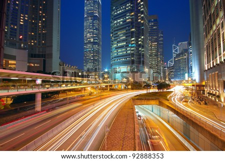 Modern Urban City with Freeway Traffic at Night, hong kong - stock photo