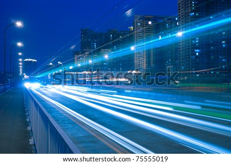 Modern urban landscape at night - stock photo