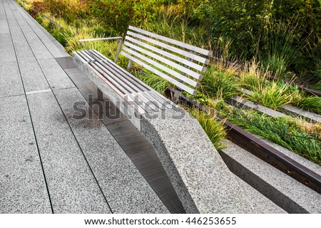 Modern urban park bench seen from the High Line in New York City in Manhattan