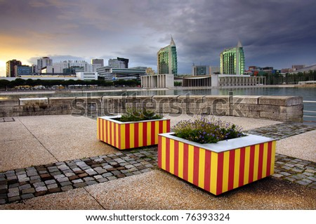 Modern urban park with high buildings in Lisbon Portugal - stock photo