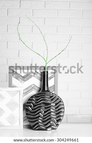 Modern vase with decor on floor in room - stock photo