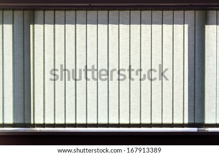 Modern vertical blinds on the window of the office - stock photo