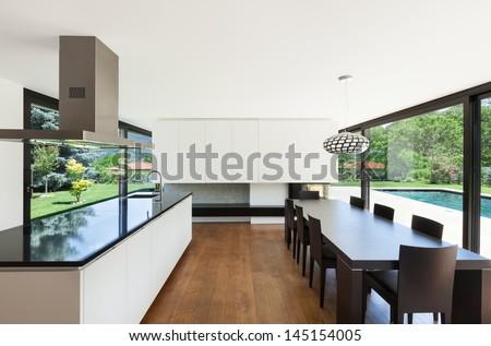 Modern villa, interior, beautiful dining room with kitchen island - stock photo