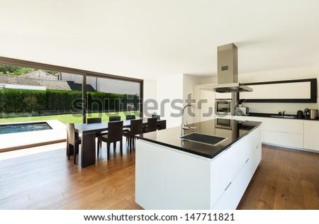 Modern villa, interior, beautiful  kitchen and dining table - stock photo