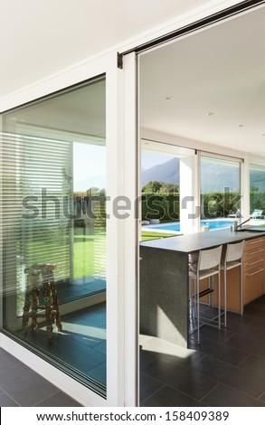 Modern villa, interior, view from the veranda - stock photo