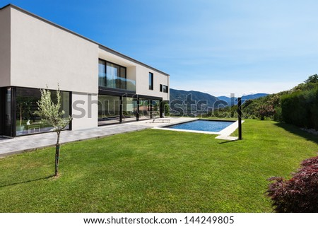 Modern villa with pool, view from the garden - stock photo