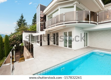 Modern villa with pool, view from the terrace - stock photo