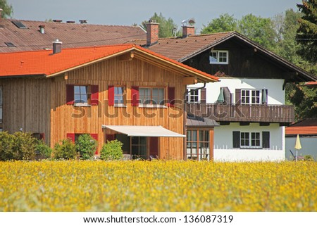 Modern village in Bavaria in the spring blossom - stock photo