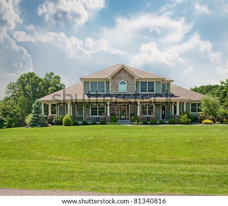 Modern vinyl siding two story farm house in USA. - stock photo