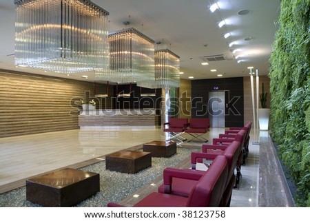 modern waiting room with floral wall - stock photo