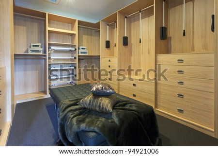 Modern walk in robe with leather chaise - stock photo