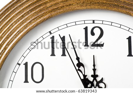 Modern wall clock shows almost twelve - stock photo
