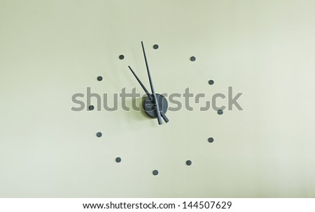 Modern wall clock with needle design, decoration and furniture - stock photo