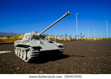 Modern War Concept Model Tank in the Middle of an Asphalt Road