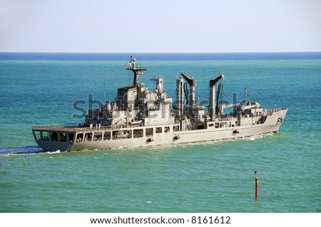 Modern warship heading out to sea - stock photo