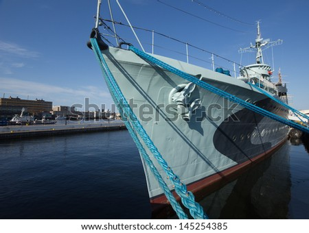 Modern warship in the bay of Gdynia, Poland, with sailing ship in background - stock photo