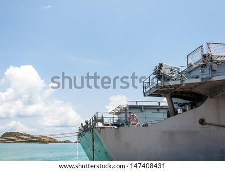 Modern warship is docking in the marine harbor.  - stock photo