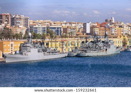 modern warships moored in port - stock photo