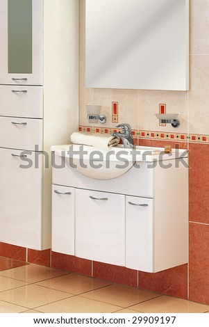 Modern wash basin with cabinet in toilet - stock photo