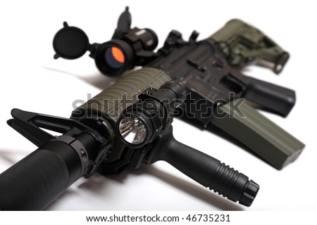 Modern weapon. US Spec Ops M4A1 custom rifle for paramilitary contractors with red dot sight, silencer and tactical flashlight. Object is on white background. Tilt view, shallow DOF. Studio shot. - stock photo