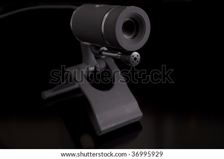 modern webcam on black background - stock photo