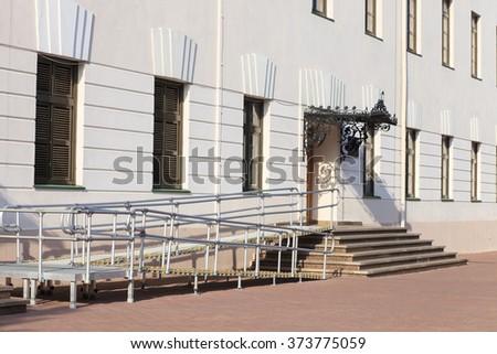 Modern wheelchair ramp in museum - stock photo