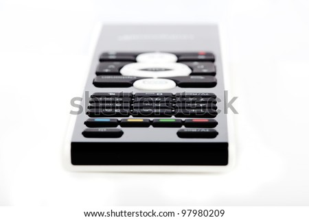 Modern white and black remote control on white background - stock photo