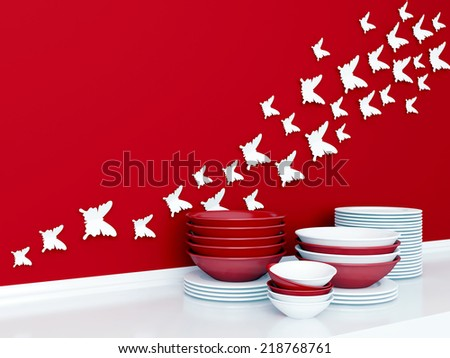 Modern white and red kitchen design. Ceramic kitchenware on the shelf. Butterfly decor on the wall. - stock photo
