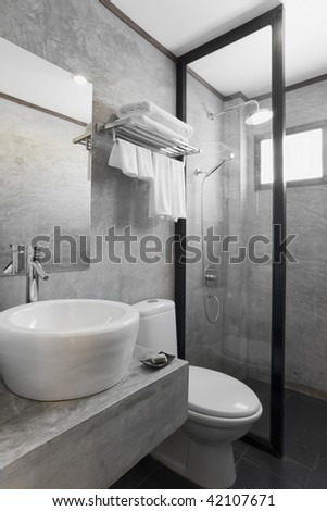 modern white bathroom with gray cement wall - stock photo