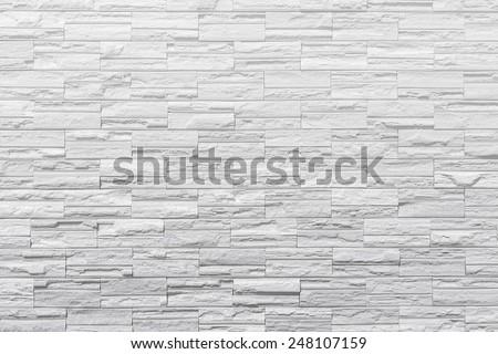 Modern white brick wall. rock wall - stock photo