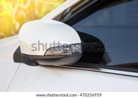 modern white car side view mirror folded with turn signal