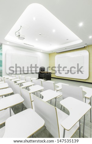 Modern white classroom with computer - stock photo