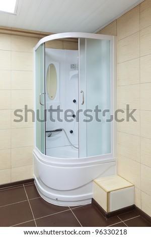 Modern white corner shower cabin, closeup - stock photo