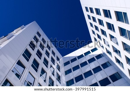 modern white facade with windows - stock photo