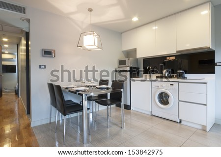 modern white kitchen in apartment. - stock photo