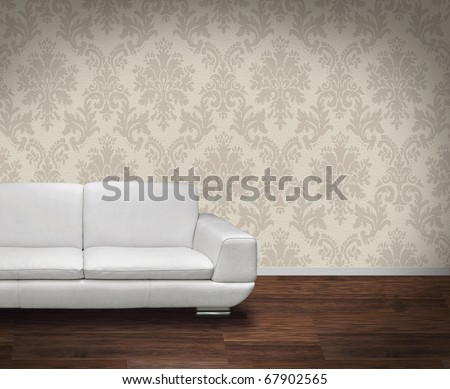 Modern white leather sofa in room with dark wooden floor