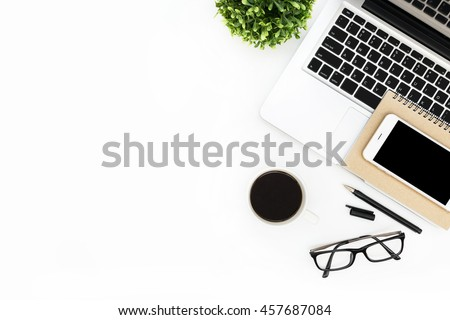 modern white office desks. Modern White Office Desk Table With Laptop Computer, Smartphone Black Screen Over A Notebook Desks
