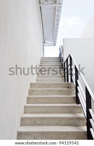 Modern white stair up to the restaurant in the urban city.