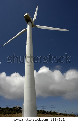 Modern white wind turbine or wind mill producing energy