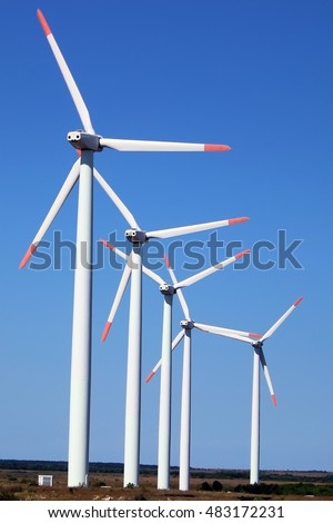 Modern wind power generators in a field
