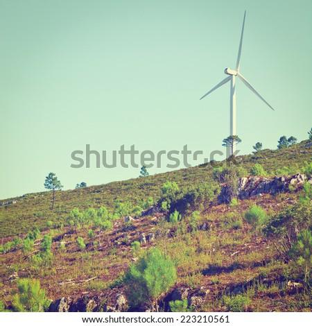 Modern Wind Turbine Producing Energy in Portugal, Instagram Effect - stock photo