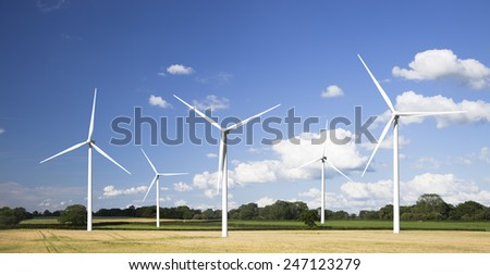 Modern wind turbines in a summer setting. - stock photo
